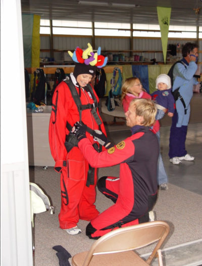Charlie Rogers mounting a harness on a student at the Wisconsin Skydiving Center