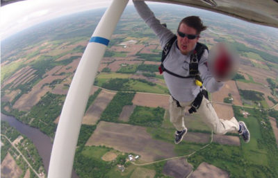 Dan Schultz, hanging off the wing during a skydive at Wisconsin Skydiving Center