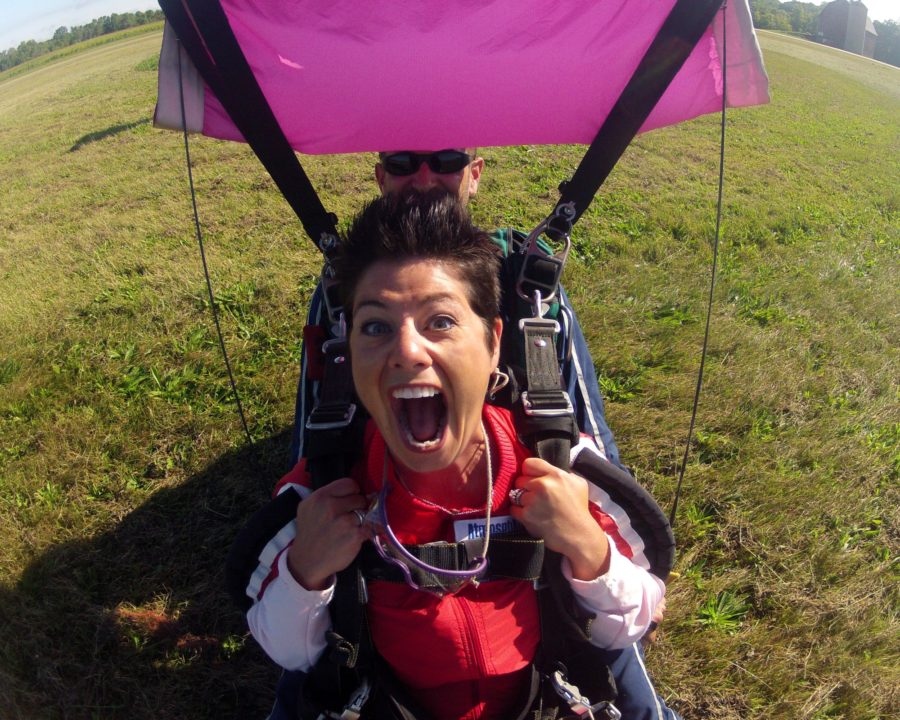 Woman screaming with joy after her first skydive at Wisconsin Skydiving Center near Milwaukee, WI