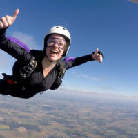 Woman giving a thumbs up as she skydives solo at Wisconsin Skydiving Center near Milwaukee, WI