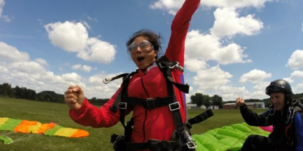 Girl celebrating her first tandem skydive at Wisconsin Skydiving Center near Chicago