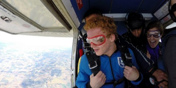Man looking out of a plane before a tandem skydive at Wisconsin Skydiving Center near Chicago
