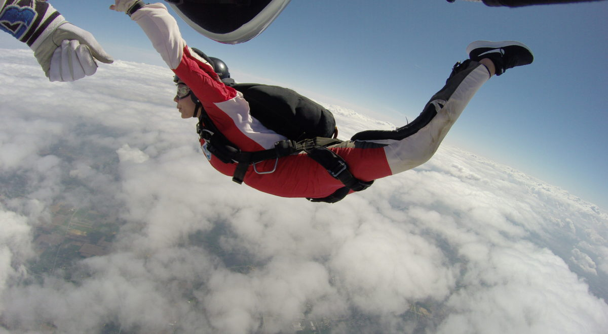An AFF student demonstrates the perfect arch during an AFF jump to get her skydive license