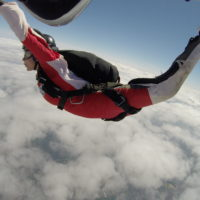A young girl learning to skydive