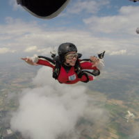 Woman solo skydiving as she trains for her skydiving license at Wisconsin Skydiving Center near Madison, WI