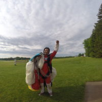 Skydiving student finishes his training and celebrates at Wisconsin Skydiving Center near Milwaukee, WI