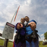 Two Tandem Skydiving Students Before Jumping