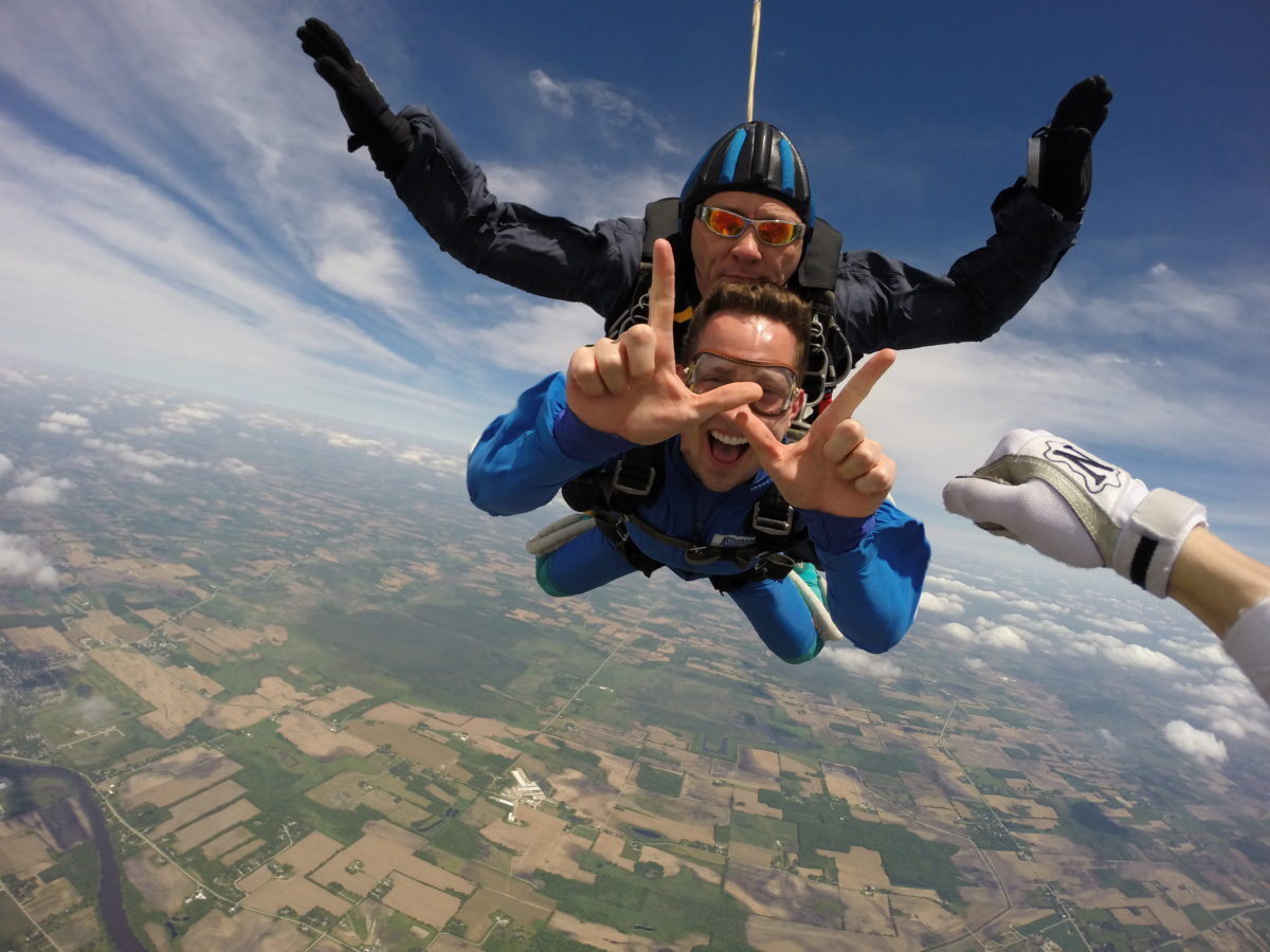 A University of Wisconsin graduate skydiving after getting a graduation gift certificate to Wisconsin Skydiving Center near Milwaukee
