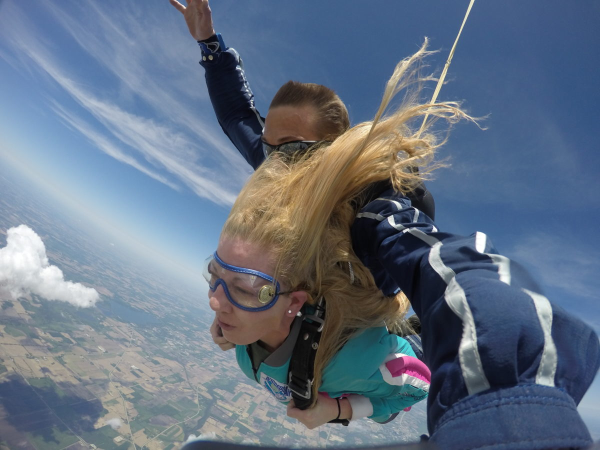 Girl's hair blowing back while skydiving at Wisconsin Skydiving Center near Chicago