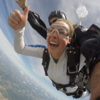 Girl smiling during freefall at Wisconsin Skydiving Center near Chicago