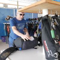 Bo Babovic packing a parachute at Wisconsin Skydiving Center near Madison, WI