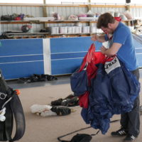 Skydiving instructor packing a parachute at the dropzone of Wisconsin Skydiving Center near Milwaukee, WI