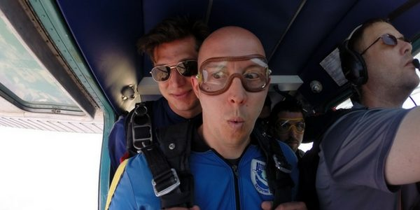 man seems unsure about taking risk to skydive