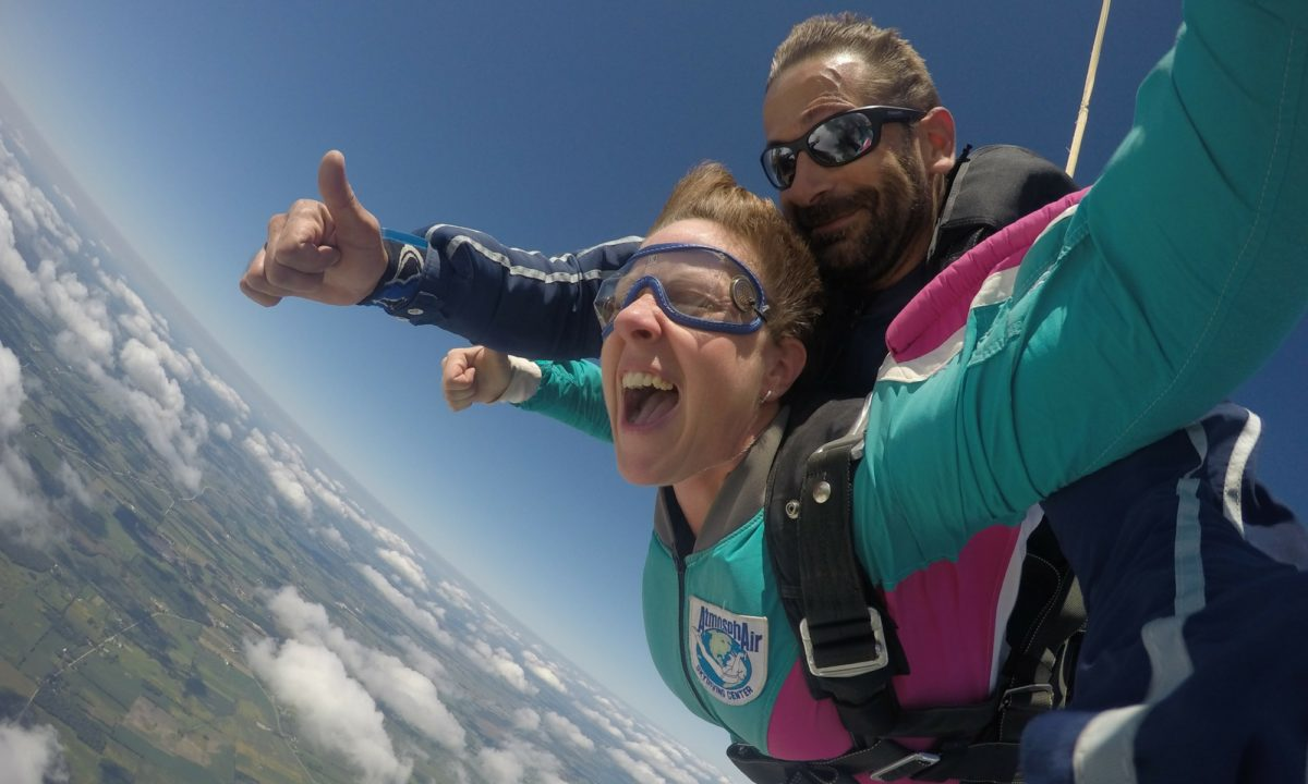 Fearless woman as part of a group skydive