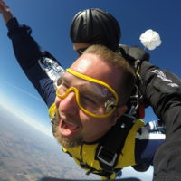Man amazed while tandem skydiving at Wisconsin Skydiving Center near Chicago