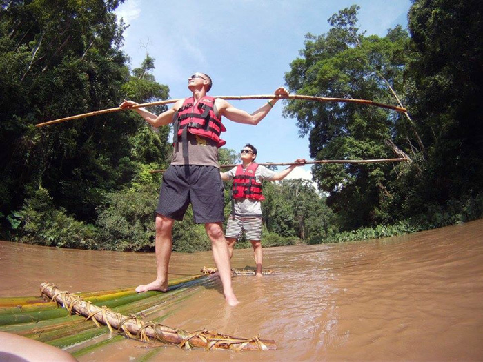 Skydiving instructor Luke Pinion on a bamboo raft