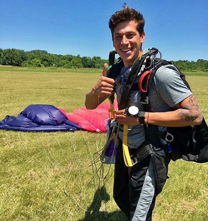 Skydiving Stories: Jake Lumsden gives the thumbs up after a successful jump.