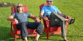 Alex and Bo relax in lawn chairs at the Wisconsin Skydiving Center dropzone