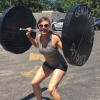 Skydiving instructor Laura Duffy lifting weights at Wisconsin Skydiving Center near Chicago