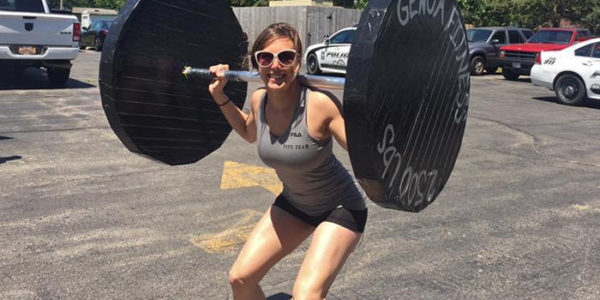 Skydiving instructor Laura Duffy lifting weights