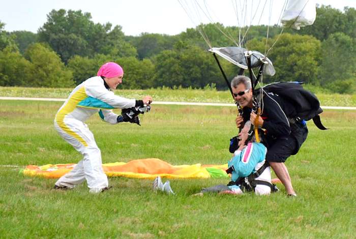Skydiving instructor Laura Duffy takes a photo of a skydiver