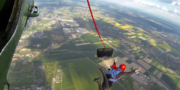 Skydiver executing a static line jump