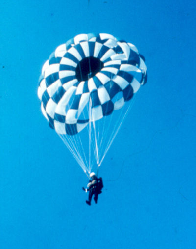 Mark descending under a round parachute