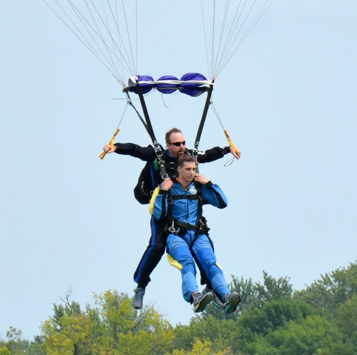 WSC's skydiving instructor Joel Graves makes a landing after a tandem jump.