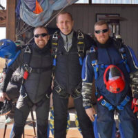 Skydiving instructor Joel Graves with two of his co-instructors.