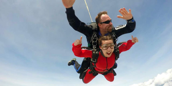 Skydiving instructor Joel Graves with happy tandem student
