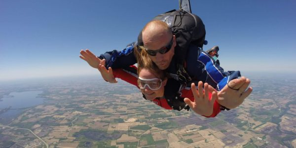 Tandem Instructor Shawn Myers on a jump with a student.