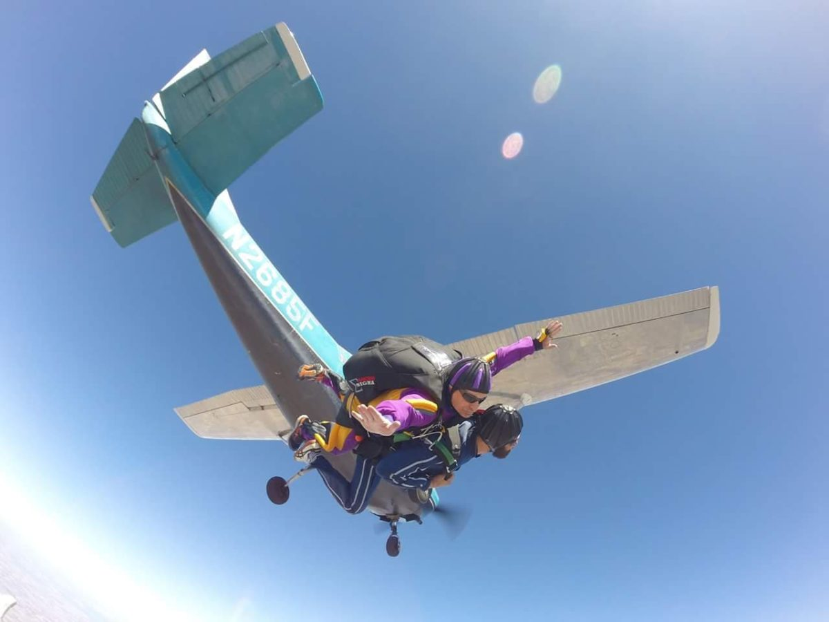 Tandem instructor Shawn exiting a Cessna 182 with a tandem student at Wisconsin Skydiving Center