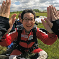 Skydiver high-fives another skydiver after his first tandem skydive at Wisconsin Skydiving Center near Milwaukee