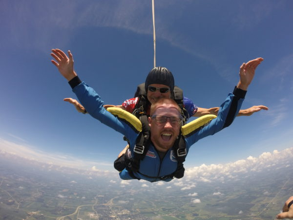 Michael spreading his arms out during his skydive.