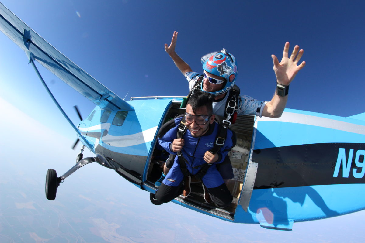 First time skydiver jumping from a plane at Wisconsin Skydiving Center near Milwaukee, WI