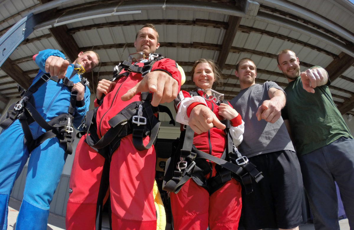 Group of people during the perfect outdoor team building activity - skydiving