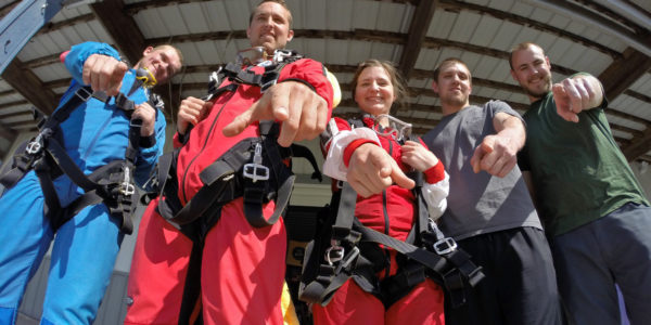 Group of people during the perfect outdoor team building activity - Wisconsin Skydiving Center near Milwaukee