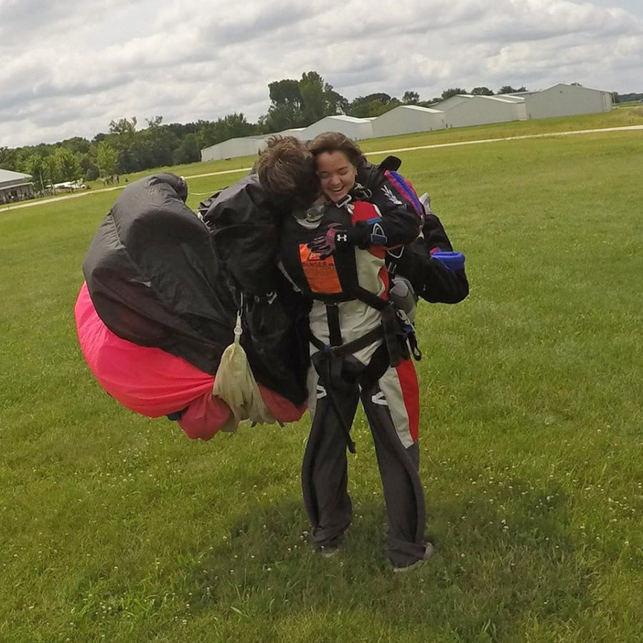 Skydiver Sarah Dillman gets a hug from Zach.