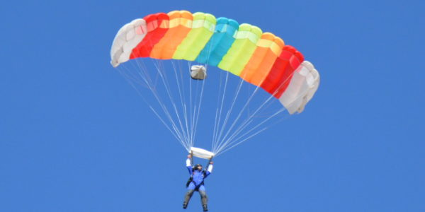 Skydiver shows how a parachute works.