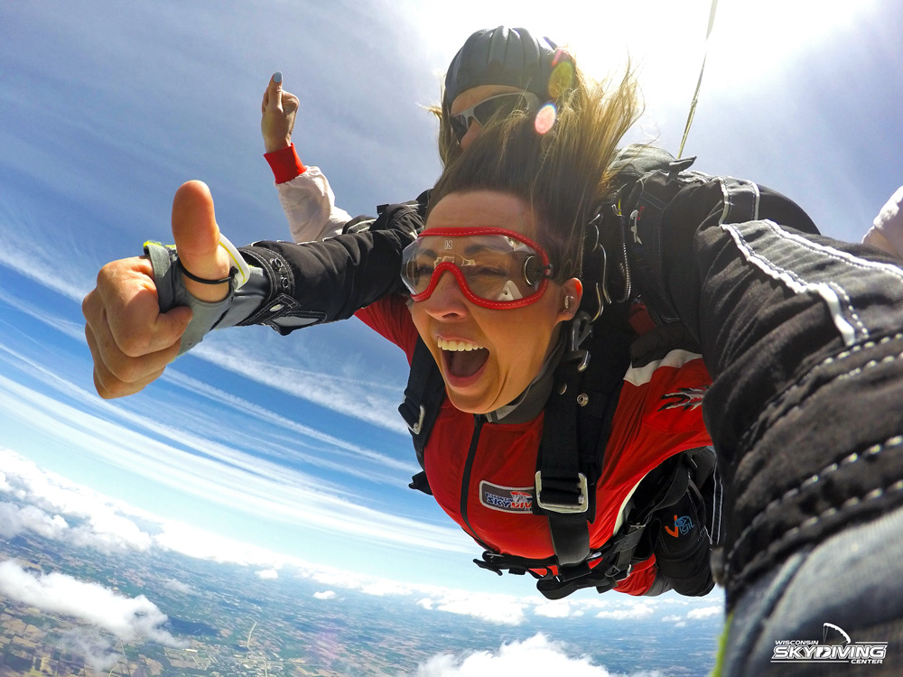 A woman wearing goggles while skydiving at Wisconsin Skydiving Center near Milwaukee