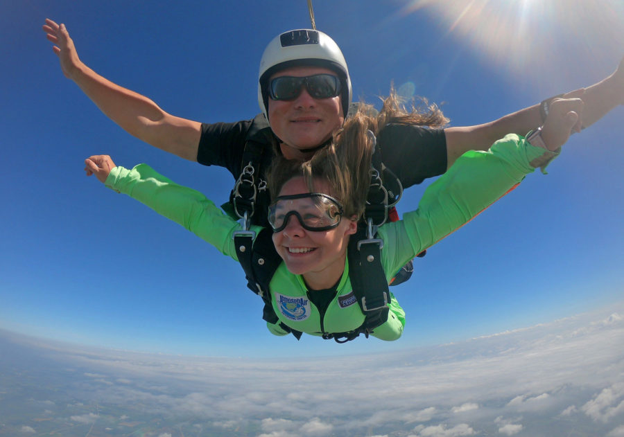 Relaxed tandem student during skydiving free fall.