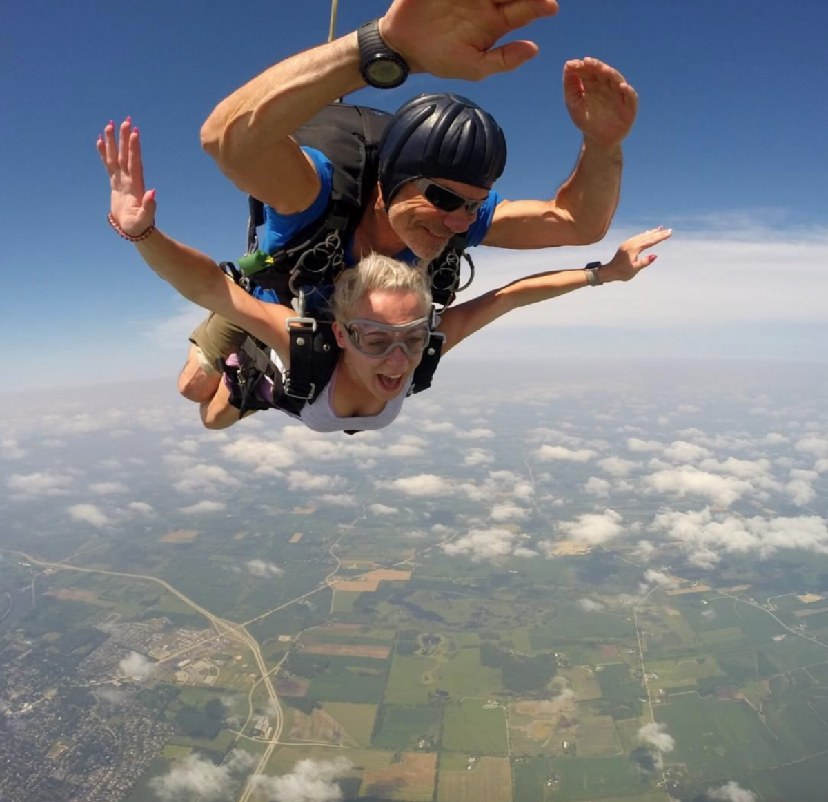 Woman in freefall in a tandem skydive at Wisconsin Skydiving Center near Milwaukee Wisconsin