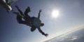 Silhouette of a tandem skydiver enjoying free fall at Wisconsin Skydiving Center near Milwaukee - When does skydiving season start?