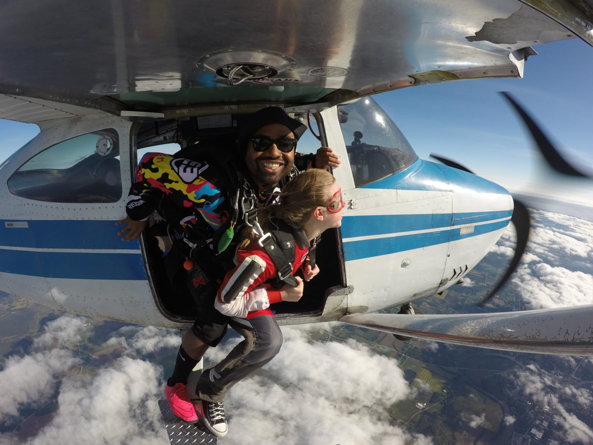 Tandem skydiver and instructor wearing the best skydiving shoes at Wisconsin Skydiving Center near Chicago