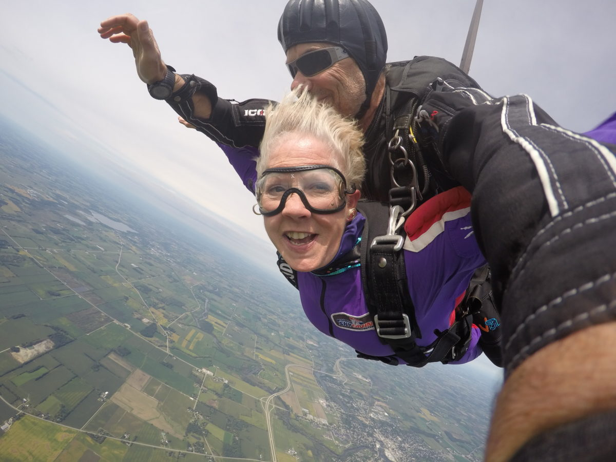 Woman smiling while tandem skydiving at Wisconsin Skydiving Center near Chicago