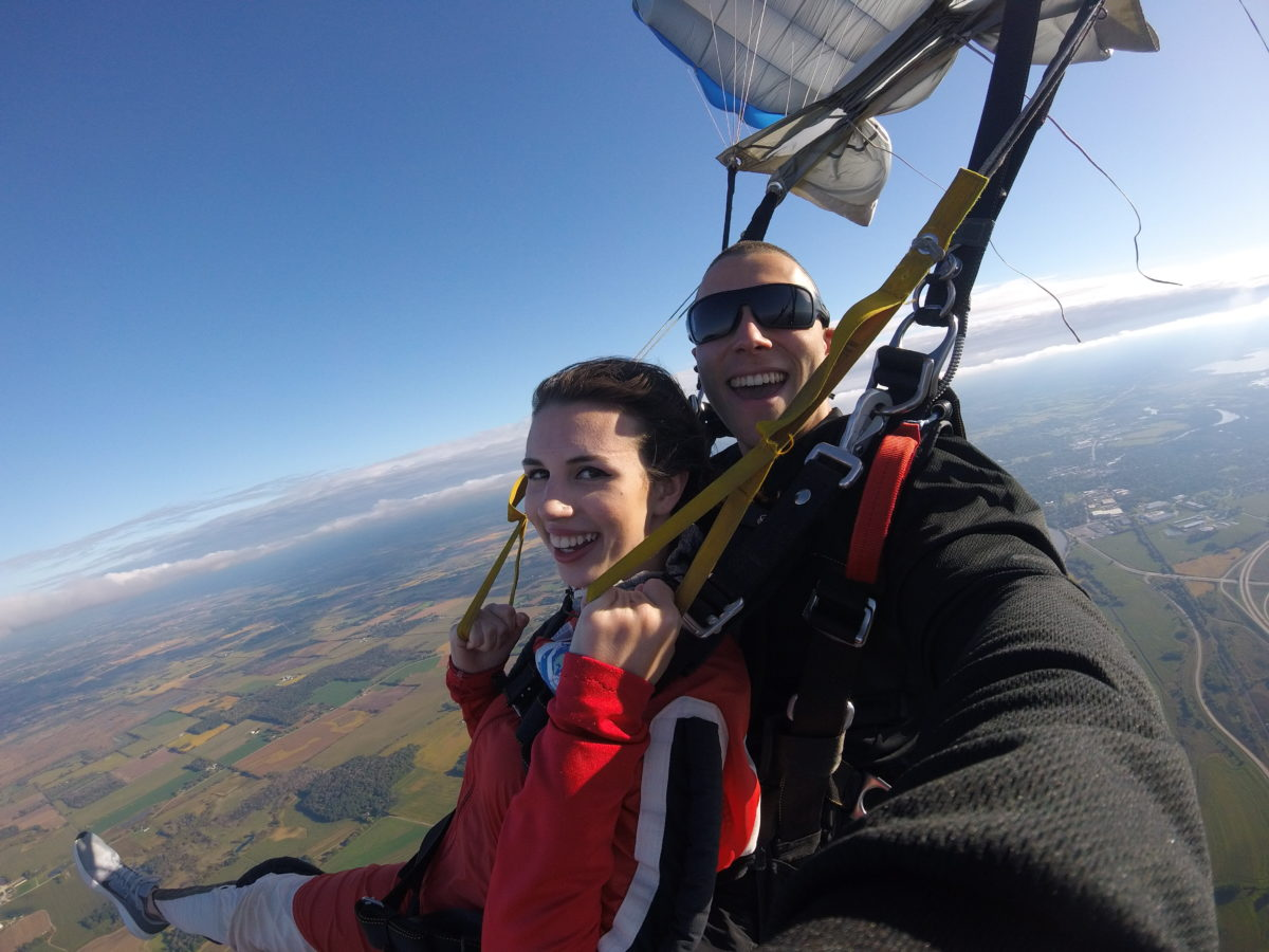 Tandem skydiver smiling with excitement as she finishes her skydive at Wisconsin Skydiving Center near Chicago