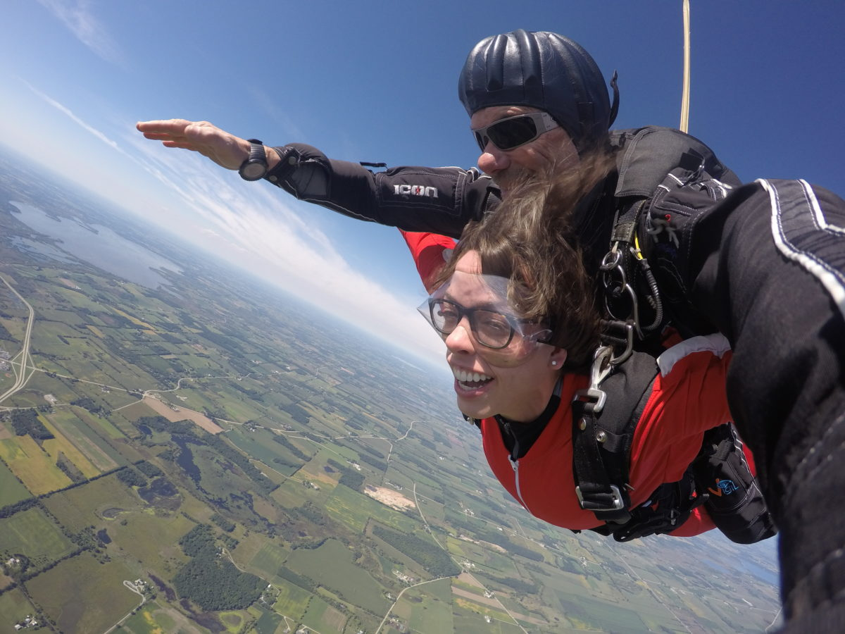 Woman skydiving while wearing glasses at Wisconsin Skydiving Center near Chicago