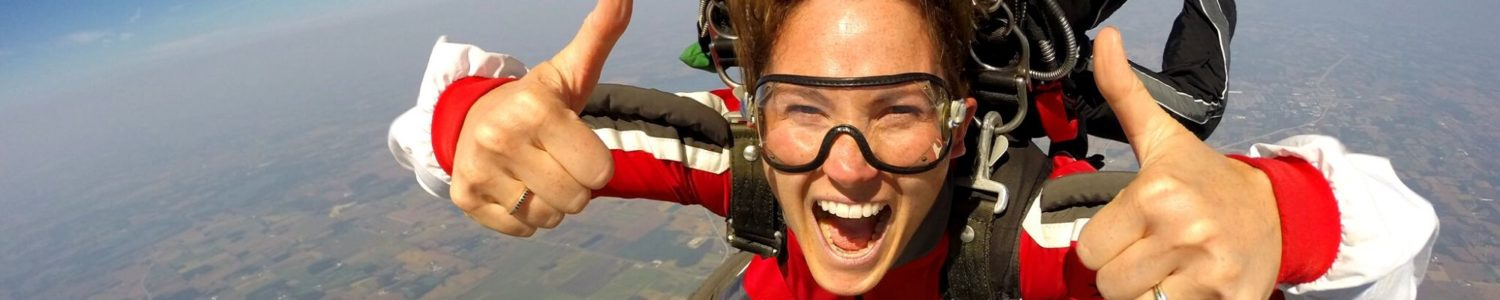 Girl smiling with thumbs up during a tandem skydive at Wisconsin Skydiving Center near Chicago