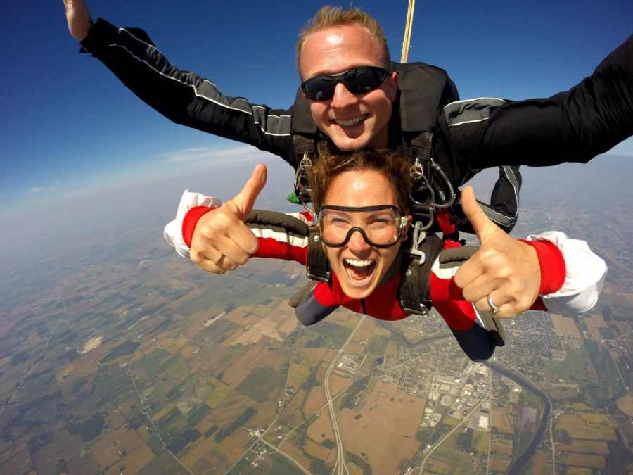 Luke Pinion smiles during a tandem skydive.