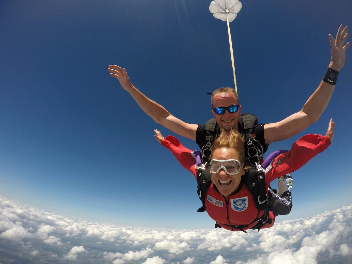 Woman smiles while making a safe tandem skydive at Wisconsin Skydiving Center near Chicago